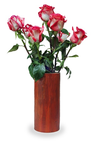 colorful flower bouquet from roses arrangement centerpiece in vase isolated on white background photo