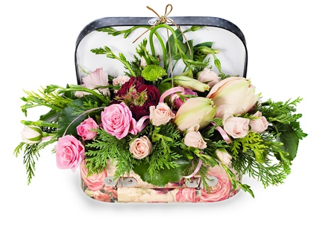 a colorful floral arrangement of roses and lilies in acardboard chest, isolated on white background photo