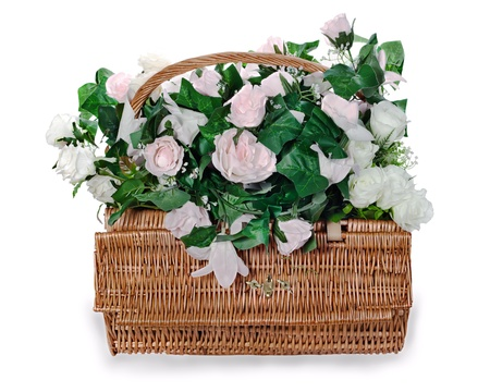 colorful flower bouquet arrangement from white and pink roses centerpiece in a wicker gift basket isolated on white background. Stock Photo - 16242124