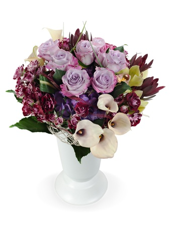 colorful floral bouquet of roses, lilies and orchids arrangement centerpiece in vase isolated on white background Stock Photo - 16242114