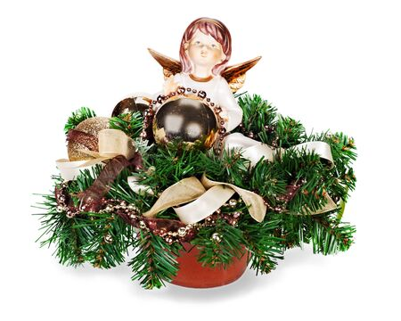 Christmas arrangement of Christmas balls, artificial flowers, beads, pine branches and  figurine of angel in vase isolated on white background photo