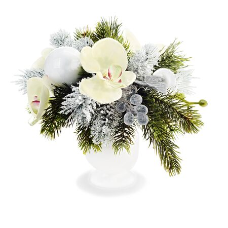 Christmas arrangement of Christmas balls, orchids, snowflakes, beads and pine branches isolated on white background photo