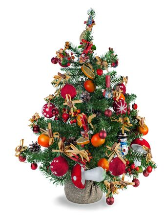 Christmas fir tree decorated with toys and Christmas decorations isolated on white background photo