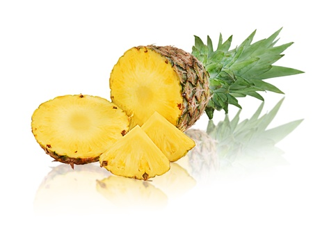 ripe pineapple with slices isolated on white background photo