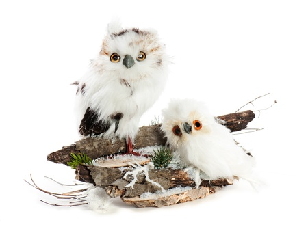 Two owls on a wooden base with snow, pine needles and snowflakes. Completely handmade. photo