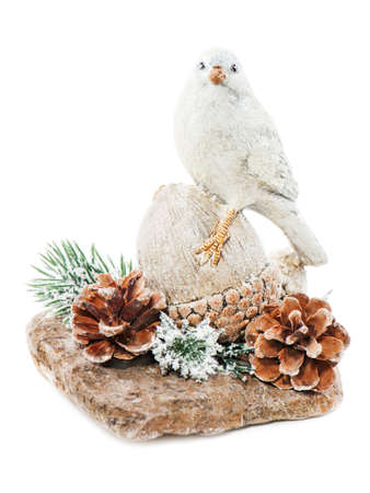 Christmas arrangement of bird on a nut with cones, pine needles and snowflakes isolated on white background  photo