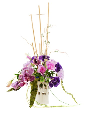 colorful floral bouquet of roses, lilies and orchids arrangement centerpiece in vase isolated on white background Stock Photo - 16666672