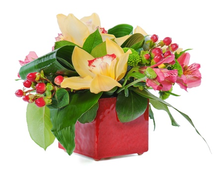 colorful floral bouquet of roses, cloves and orchids arrangement centerpiece in vase isolated on white background Stock Photo - 16811530