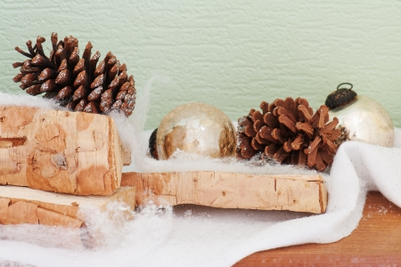 abstract composition from birch logs, Christmas balls and cones photo