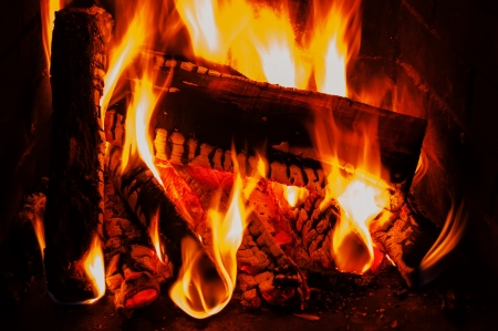 fireplace with wood and fire photo