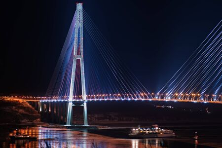 night view of the longest cable-stayed bridge in the world in the Russian Vladivostok over the Eastern Bosphorus strait to the Russky Island Stock Photo - 17206917