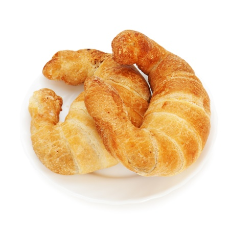 fresh and tasty croissant on plate isolated on white background Stock Photo - 17687832