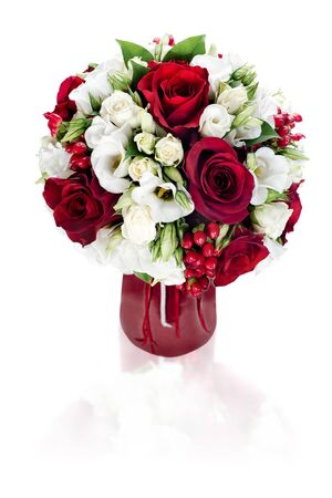 colorful flower bouquet arrangement centerpiece in red vase isolated on white background photo