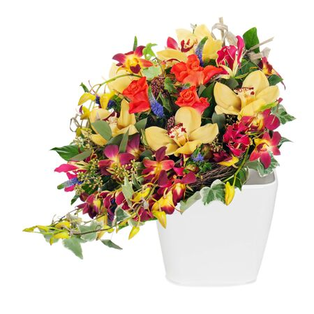 colorful floral bouquet of roses, cloves and orchids arrangement centerpiece in vase isolated on white background Stock Photo - 17687849
