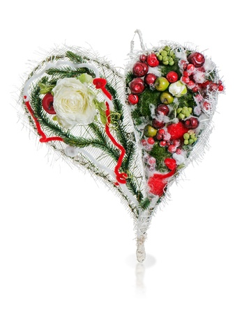 abstract composition in the form of heart from apples, balloons, roses and pine needles isolated on white background photo
