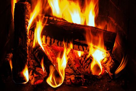 fireplace with oak firewood and flame Stock Photo - 17989565