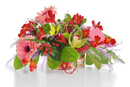 Floral arrangement from lilies, cloves and orchids in cardboard chest on white  Stock Photo