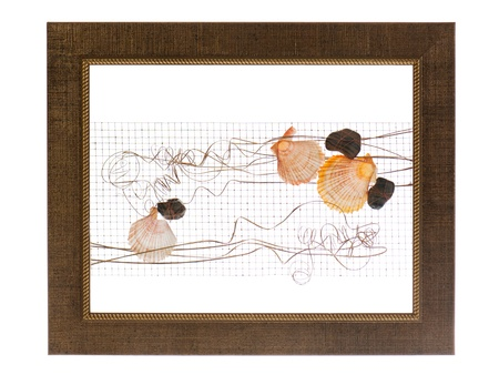 decorative photo frame with abstract composition of shells, stones and wire isolated on white background photo