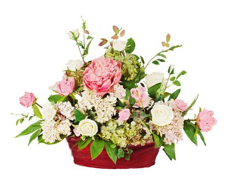 Colorful floral bouquet from roses and cloves arrangement centerpiece in vase isolated on white background photo