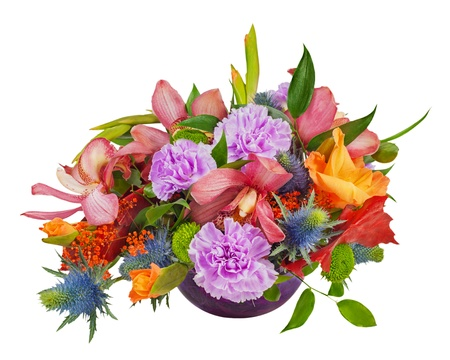 Floral bouquet of orchids, gladioluses and carnations arrangement centerpiece in blue glass vase isolated on white background Stock Photo