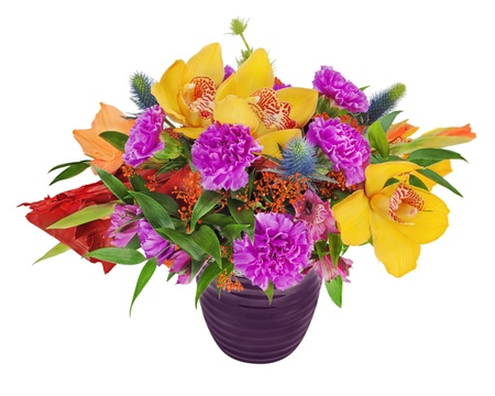 Floral bouquet of orchids, gladioluses and carnation arrangement centerpiece in blue vase isolated on white background photo