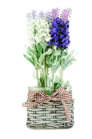 Composition of artificial garden flowers in decorative vase isolated on white background  photo