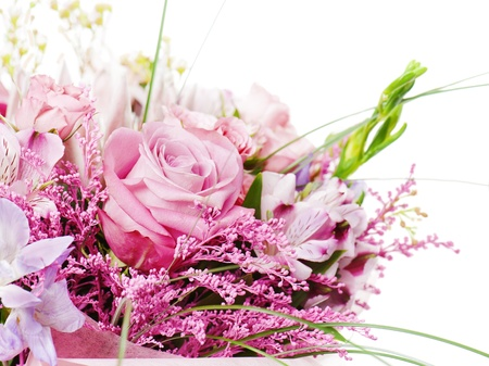 flower bouquet: fragment of colorful bouquet of roses, cloves, orchids and freesia isolated on white background