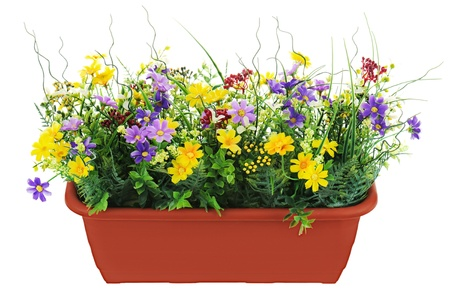 Composition of artificial garden flowers in decorative flowerpot isolated on white background  photo