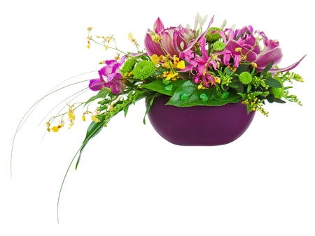 Colorful flower bouquet arrangement centerpiece in vase isolated on white background Closeup  photo