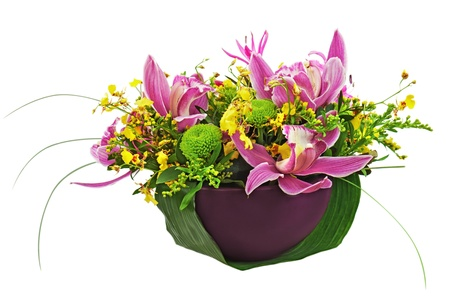 Bouquet from orchids and lilies in vase isolated on white background. Closeup. photo