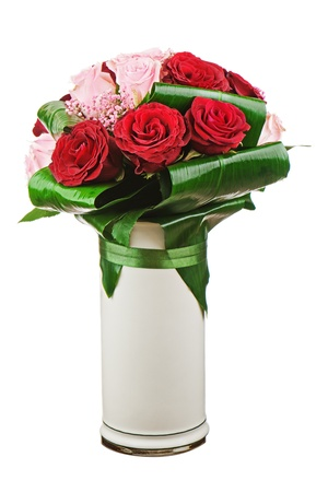 Colorful flower bouquet from roses in white vase isolated on white background.  Closeup. photo