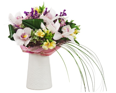 Bouquet from orchids in white vase isolated on white background. Closeup.