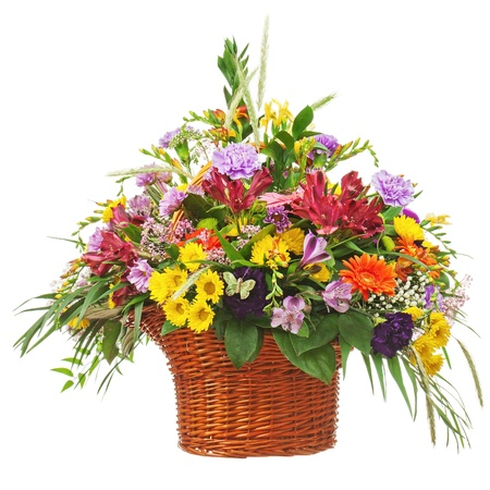 Colorful flower bouquet arrangement centerpiece in wicker basket isolated on white background. Closeup. Banco de Imagens