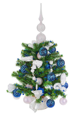 Christmas fir tree decorated with Christmas balls, snowflakes, candles , beads and pine branches isolated on white background photo