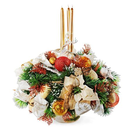 Christmas arrangement of Christmas balls, snowflakes, candles , beads and pine branches in vase isolated on white background photo