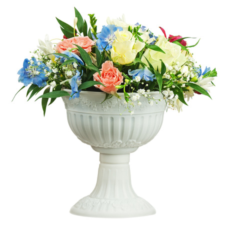 blue flowers: Colorful flower bouquet arrangement centerpiece in vase isolated on white background. Closeup. Stock Photo