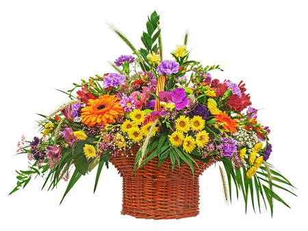 Flower bouquet arrangement centerpiece in wicker basket isolated on white background. Closeup. photo