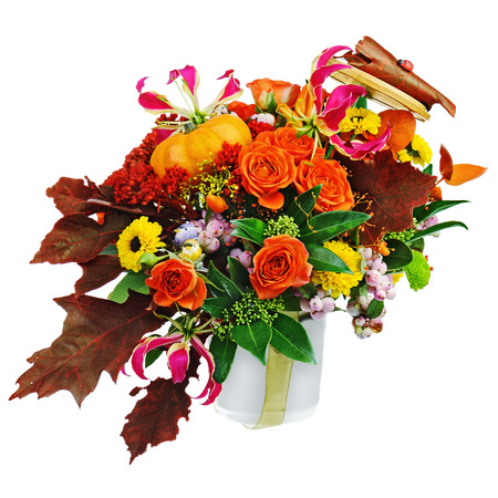 Autumn arrangement of flowers, vegetables and fruits isolated on white background. Closeup.