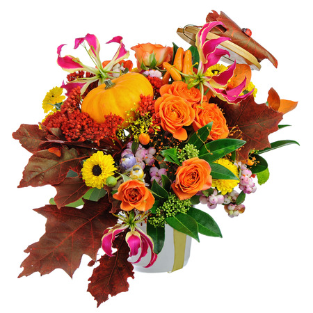 autumn arrangement: Autumn arrangement of flowers, vegetables and fruits isolated on white background. Closeup.