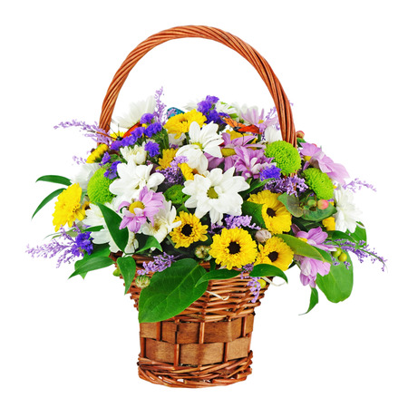 Flower bouquet in wicker basket isolated on white background. Closeup. photo