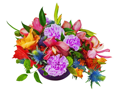 Floral bouquet of orchids, gladioluses and carnations arrangement centerpiece in blue glass vase isolated on white background. Stock Photo