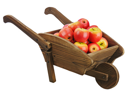 pushcart: Red apples on wooden pushcart isolated on white background. Closeup.