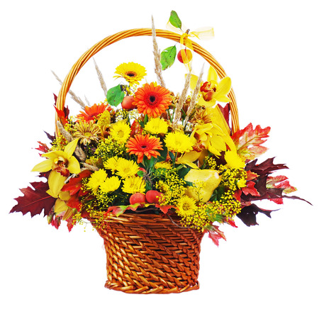Colorful flower bouquet arrangement centerpiece in wicker basket isolated on white background. Closeup. photo