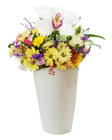 Colorful flower bouquet in vase isolated on white background. Closeup. photo
