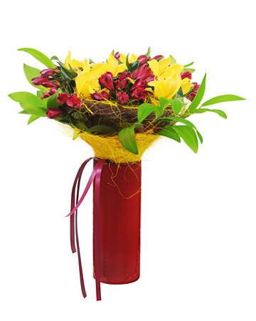 Colorful flower bouquet arrangement centerpiece in red vase isolated on white background. Closeup. photo