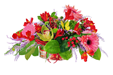 Floral arrangement from lilies, gerbera flowers and orchids in cardboard chest isolated on white. Closeup.  photo