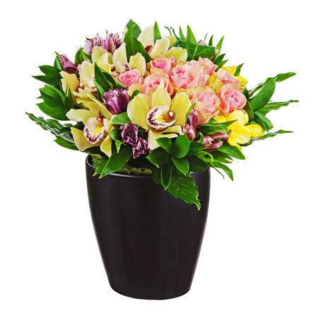 Floral bouquet of roses, lilies and orchids arrangement centerpiece in black vase isolated on white background. Closeup. photo