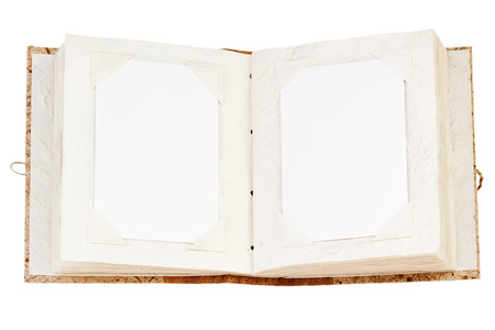 Open old photo album with place for your photos isolated on white background. Closeup.
