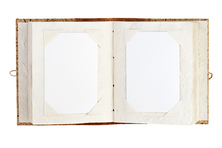 family history: Open old photo album with place for your photos isolated on white background. Closeup.