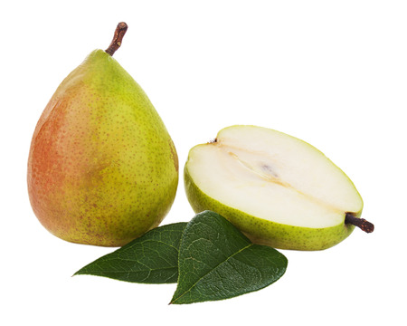 Ripe pear with cut and green leaves isolated on white. Closeup. photo